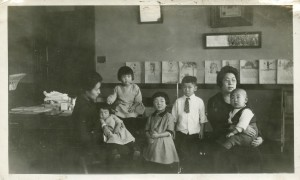 School meeting in Whitefish, ca. 1926. Cho is far left, holding Fumi. Yuki is sitting, right of her mother Cho.